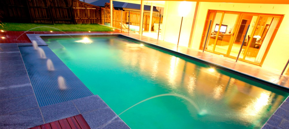 Beautiful pool by night with pool lights on